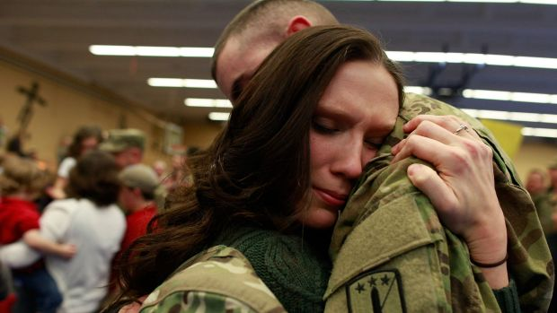 A soldier of the 170th US Army Infantry Brigade is greeted upon his return from Afghanistan at a US Army base in Germany ...