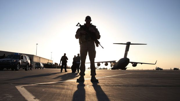 A soldier stands guard near a C17 military transport plane that brought then US defence secretary Chuck Hagel to ...