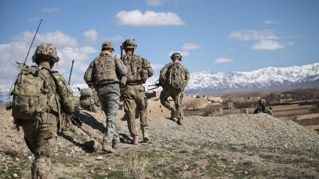 US soldiers patrol into a village near Pul-i-Alam, Afghanistan, in March 2014.