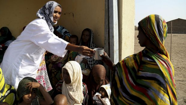 Mothers feed their babies moderate acute malnutrition (MAM) food at a health post in Dubti, Ethiopia's Afar region.