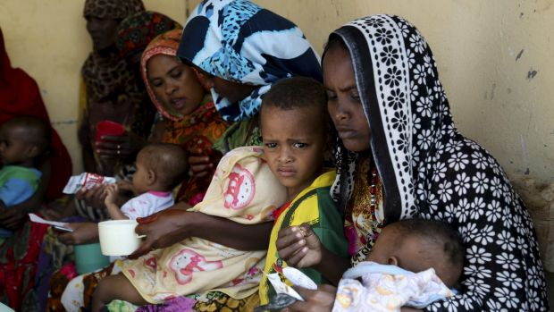 Mothers feed their children at a health post in Dubti, Ethiopia, earlier this month.