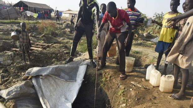 Displaced people draw water from a well, in the UN camp for displaced people in Juba earlier this month.