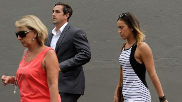 Mitchell Pearce arrives to speak at a press conference in Surry Hills on Friday with his mother Terri, left, and sister ...