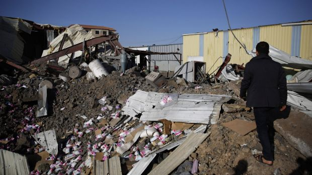 A worker walks on the rubble of a food factory destroyed by Saudi-led airstrikes in Sanaa earlier this month. The United ...