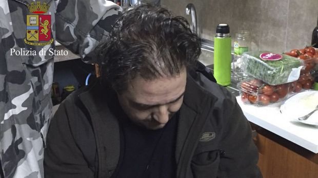 10 years on the run ... Giuseppe Crea, 37, sits in the hidden bunker where he was arrested. Italian police discovered ...
