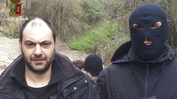 Giuseppe Ferraro is taken into custody after he was arrested in a bunker in southern Calabria. Ferraro, 48, was ...