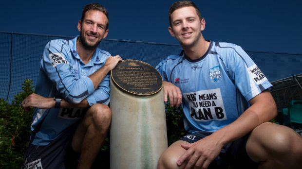 Honour: Trent Copeland and Josh Hazlewood with the Ray Lindwall monument.