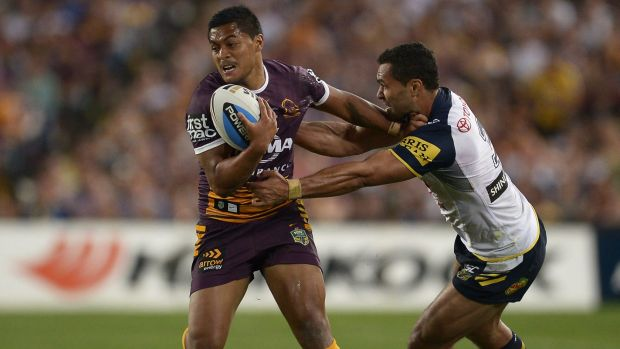 Anthony Milford of the Broncos is tackled during the 2015 NRL Grand Final.