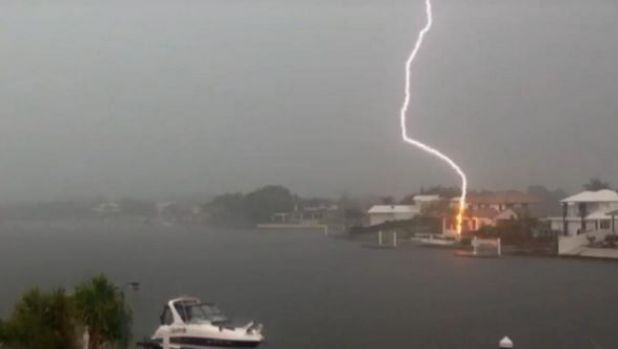 Lightning strikes a house on Kawana Island on the Sunshine Coast.