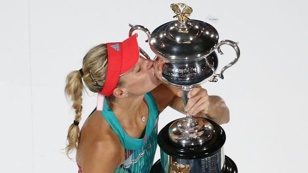 Grand: Angelique Kerber poses with the trophy.
