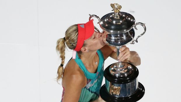 Angelique Kerber poses for photos with the trophy.