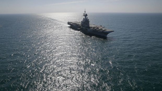 France's flagship Charles de Gaulle aircraft carrier navigates in the Persain Gulf as part of the US- led coalition ...