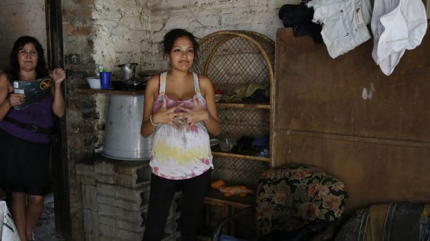 Kerly Ariza, 17 and 20-weeks-pregnant, right, at home in Ibague, Colombia. She was diagnosed with clinical symptoms of ...