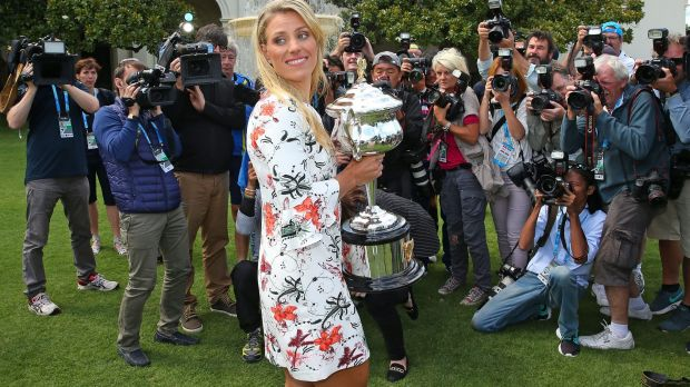 The day after the night before: Australian Open champion Angelique Kerber  holds the Daphne Akhurst Memorial Cup at ...