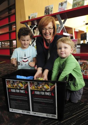 Minister for Municipal Services Meegan Fitzharris at the Gungahlin Library. Book fees are being waived in return for ...