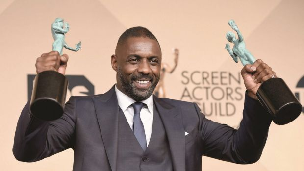 Idris Elba, winner of Outstanding Performance by a Male Actor in a Supporting Role for <i>Beasts of No Nation</i>, and ...