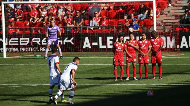 Bricking it: Adelaide players form a wall as Enver Alivodic prepares to take a free kick.