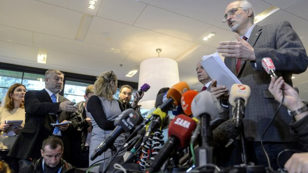 The Syrian government's chief negotiator and the country's ambassador to the UN, Bashar Jaafar, addresses the media in ...
