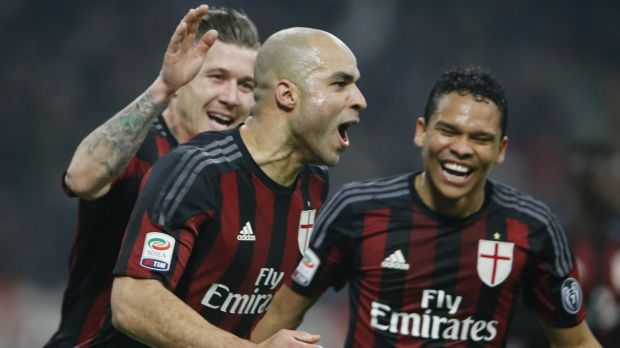 AC Milan's Alex celebrates with his teammates Juraj Kucka, left, and Carlos Bacca.