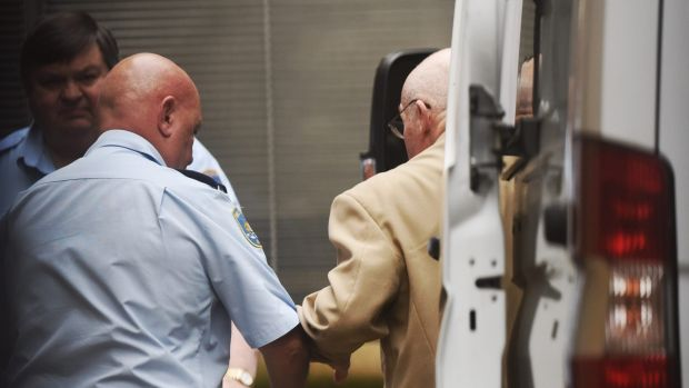Roger Rogerson led into St James Supreme Court in Sydney charged along with Glen McNamara with murder.