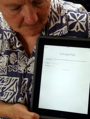 Suzanne McCarthy with her locked ipad purchased at Sydney Airport Auction