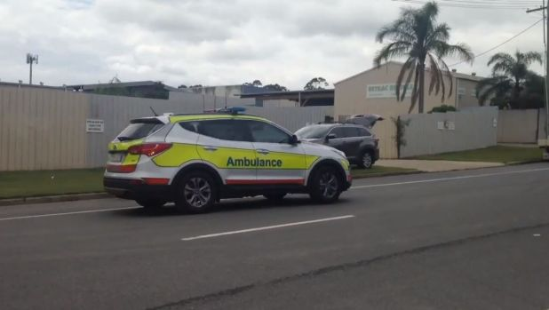 Ambulance officers at the scene of an incident at an industrial estate in Arundel, on the Gold Coast.