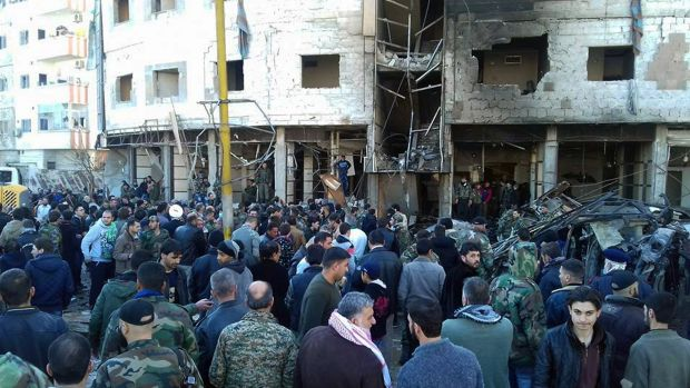 Syrians gathered at the site where three bombs exploded in Sayyda Zeinab, a predominantly Shiite Muslim suburb in ...