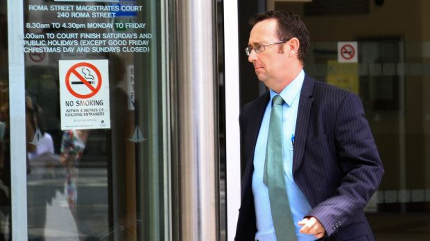 Craig Pratt, defence solicitor for Senior Constable Colin Randall, leaves the Roma Street Magistrates Court on Monday.