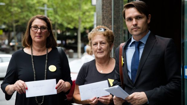 Anti-CSG protestors present letters to the Sydney office of Santos' new chief executive, Kevin Gallagher.
