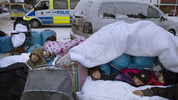 Children from Syria sleep outside the Swedish Migration Board in Marsta, Sweden, in January.
