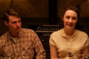 Emory Cohen as Tony and Saoirse Ronan as Eilis in <i>Brooklyn</i>.