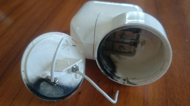 Peter Neumeister's broken Apple wall adapter caused an electric spark.