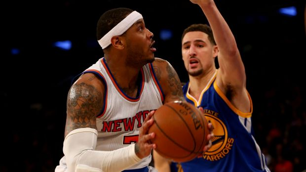 Tight defence: Carmelo Anthony heads for the net as Klay Thompson moves in.