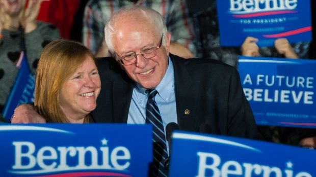 Outspoken socialist ... Democratic US presidential candidate Bernie Sanders, hugs his wife Jane after a campaign rally ...