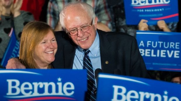 Bernie Sanders hugs his wife Jane after a campaign rally at Grand View University in Des Moines, Iowa.