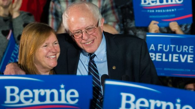 Democratic presidential candidate Bernie Sanders hugs his wife Jane after a campaign rally at Grand View University in ...