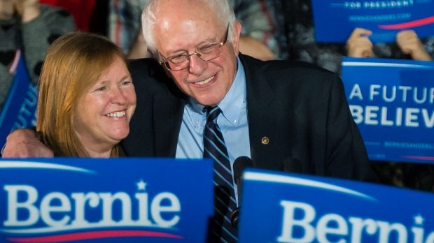 Democratic presidential candidate Bernie Sanders, hugs his wife Jane after a campaign rally at Grand View University in ...