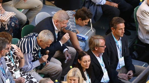 Communications Minister Mitch Fifield eating a Connoisseur ice-cream at the men's singles final of the Australian Open ...