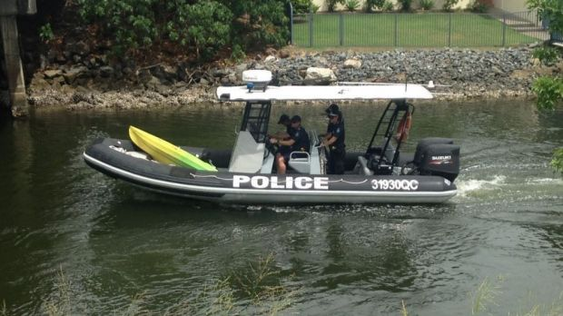 Gold Coast water police with a kayak found in a canal. They are still searching for the owner.