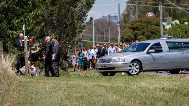 The funeral procession outside the gates of Karen Chetcuti's home.