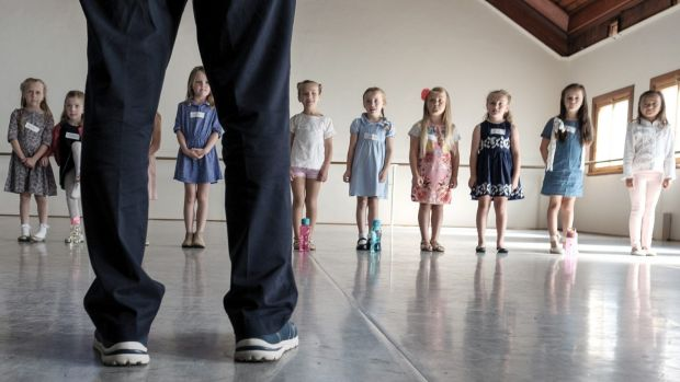 Children try their luck at auditions for the Melbourne production of The Sound of Music. Summer Moore (far right) made ...
