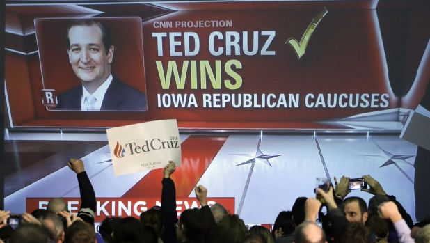 Cruz supporters cheer as caucus returns are reported.