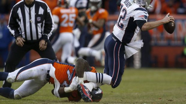 In action: DeMarcus Ware sacks New England quarter back Tom Brady during the AFC Championship game.