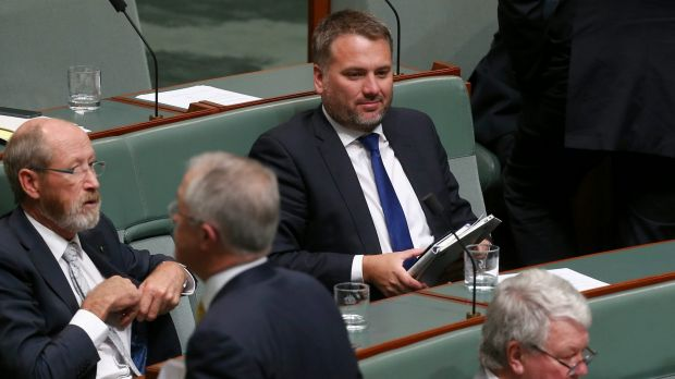 Prime Minister Malcolm Turnbull walks past Jamie Briggs at the end of question time on Tuesday.