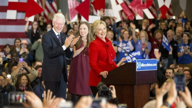 Democratic presidential candidate Hillary Clinton, accompanied by former President Bill Clinton and their daughter ...
