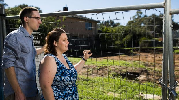 Chris and Christina Pilkington outside their cleared Ainslie Fluffy block, for which the government wants $725,000.