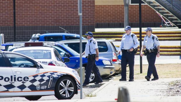 ACT police outside Canberra's Lanyon High School on Tuesday after a bomb threat.