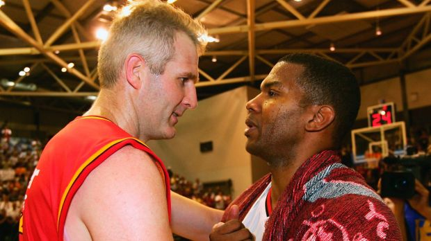 Worthy foes: Ricky Grace is congratulated by Andrew Gaze after playing his last game, during the NBL Elimination Final ...