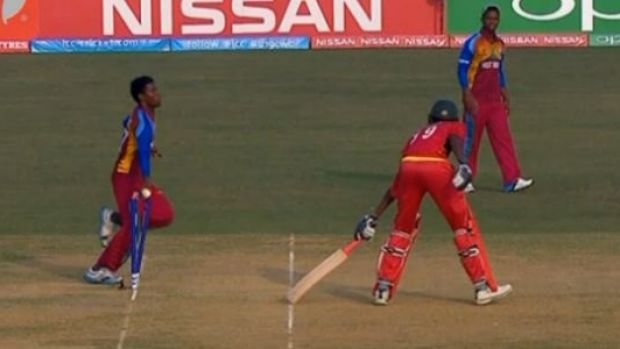 Tricky: Keemo Paul runs out Zimbabwean batsman Richard Ngarava.