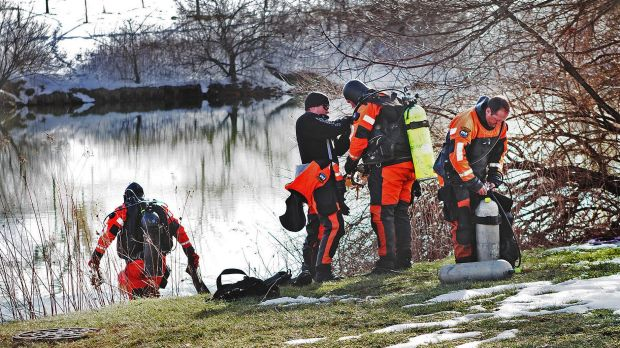 Troopers prepare to search the Duck Pond in Blacksburg, Virginia as part of the investigation in the death of Nicole ...